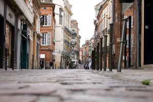 A street of cobblestone with old and pretty buildings