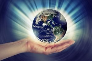 a hand holding the Earth model