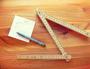 a folding ruler and a piece of paper