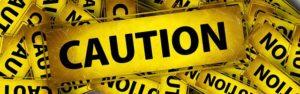 avoid fraudulent moving companies - caution on yellow tape