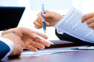 Man's and woman's hands holding documents