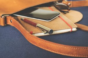 a planner, a phone and a pen